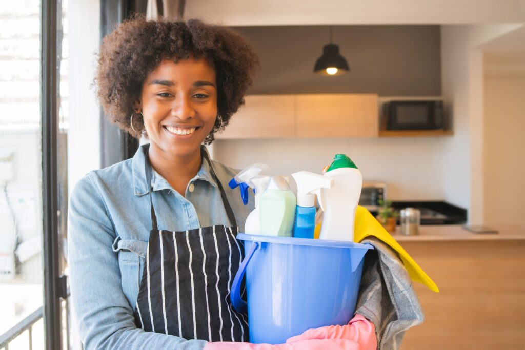 Woman Holding Cleaning Stuff